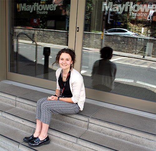 Katie, work experience student, sits outside the foyer